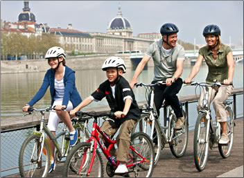Family uses complimentary bicycles during a family-friendly European river cruise.