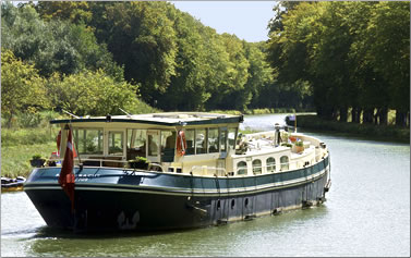 Barging on Europe's canals, rivers and waterways, Barge ASLAUG cruises in France Belgium and Holland.