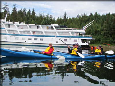 Senior paddlers enjoy a double kayak day of paddling on the protected waters of Alaska's Inside Passage.