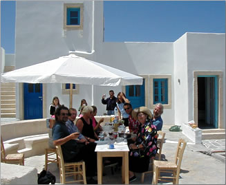Guests on outdoor terrace of Ampelos Resort, Folegandros, Greek Islands.
