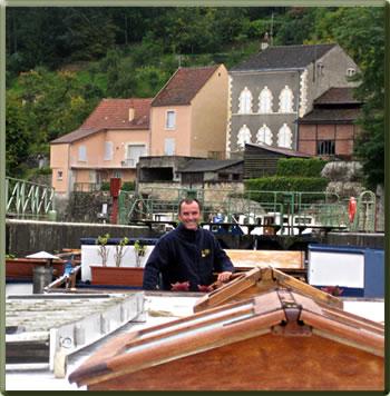 Captain Laurent aboard L'Art de Vivre on the Canal du Nivernais, Burgundy.