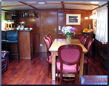 Barge saloon on Burgundy, France canal.