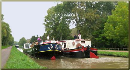 Two barges on Canal du Nivernais, Burgundy, France.