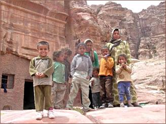 Bedouin children in Jordan greet visitors on a hike to Mount Aaron near Petra.