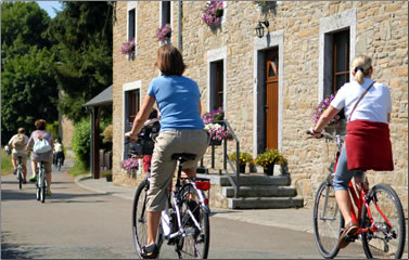 Visitors on a village holiday in Belgium opt for a few hours of cycling.