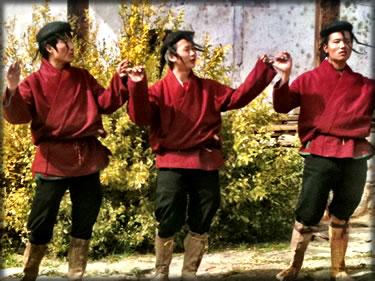 Bhutan traditional male dancers at wedding in Bhutan.