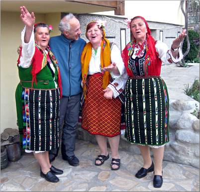 Owners of a Bulgarian guest house welcome visitors, rural holidays in Europe.
