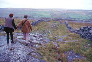 Walking across the Burren of County Clare, Ireland.