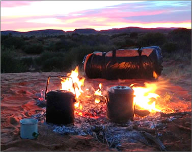 Dinner cooking and camping in Australia's Simpson desert.
