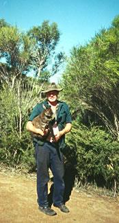 Kangaroo Island resident holds wallaby.