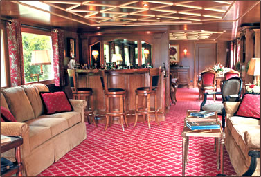 French Country Waterways Barge Adrienne salon, bar and dining area.