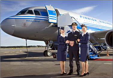 Finnair flight crew on runway in front of plane, stories about airplane travel.