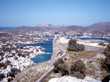 Greek Island with medieval fortress and picturesque harbor