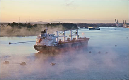 Freighter cruises up the Columbia River towards Portland, Oregon.