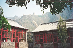 Walking the Great Wall of China on a senior travel hiking vacation.