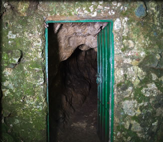 Secure green door on most western European Ice Age art caves.