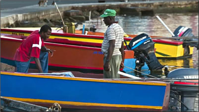 Colorful Caribbean fishing boats make great photo opportunities during a homestay on any of Grenada's three islands.
