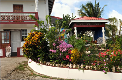 In Westerhall, Caribbean homestay budget accommodation, Grenada affordable holiday accommodation amid lovely tropical gardens.