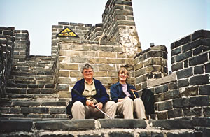 Senior travel hikers on the Great Wall of China.