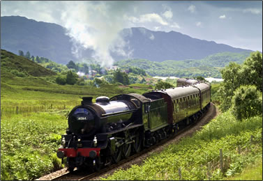 Steam train travels in the Highlands of Scotland.