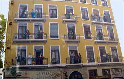 Murals on buildings in Lyon, France.