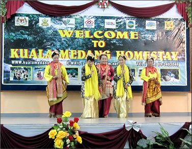 Cultural song and dance performance in Malaysia village.