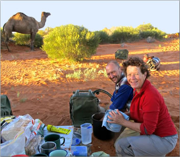 Washing up the dishes before camel trekking in Australia's Simpson Desert.