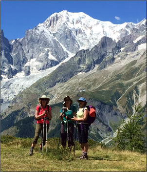 Three ladies trekking Mont Blanc, senior-friendly hiking in Europe.