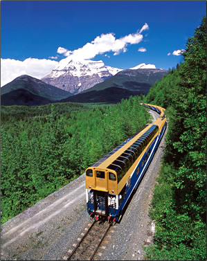 Ride the rails aboard the Rocky Mountaineer on a Jasper to Vancouver journey, Mount Robson in background.