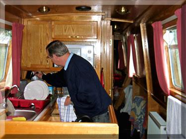 Washing up the dishes while narrow boat cruising British waterways.