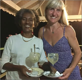 During a Homestays Grenada visit, volunteer and learn at an organic farmer's farm and share a relaxing ice cream afterwards.