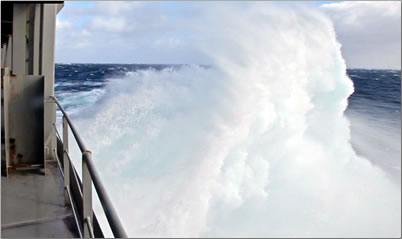 Pacific Ocean waves across container ship.