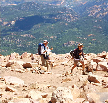 Two seniors hike to the top of Pikes Peak in Colorado.