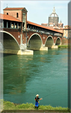 Pavia's Ponte Coperto on a culinary walking holiday in Italy.