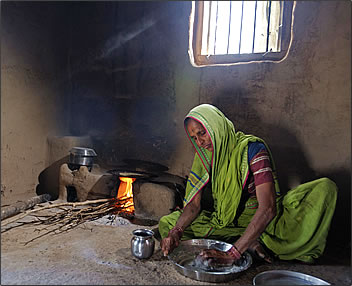 Preparing roti for a meal at India's Peacock Village, Morachi Chincholi.