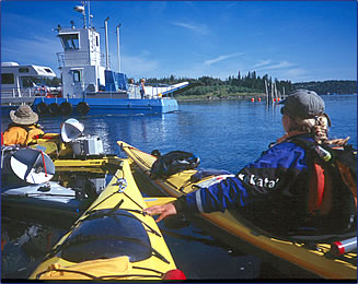 Sea kayakers travel from Maine, U.S.A. to New Brunswick, Canada on North America's east coast.