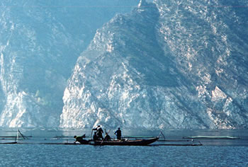 Chinese reservoir with fish farming near Great Wall of China.