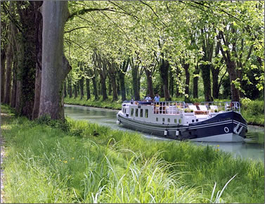 Saint Louis barge cruises the canals of France.