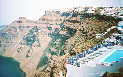 Santorini villages overlook a 1000 foot sea-filled crater