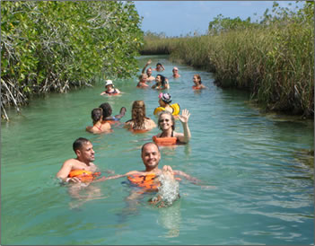 Swimming on the natural waterways and canals of Sian Kaan Biosphere Reserve.