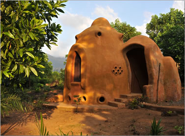 The ultimate mud hut welcomes visitors to an eco-village in Sierra Leone: sleeping comfortably in strange places.