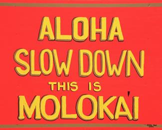 """Molokai """"slow down"""" sign."""