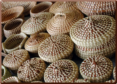 Weave your own souvenir sweetgrass basket in South Carolina on holiday.