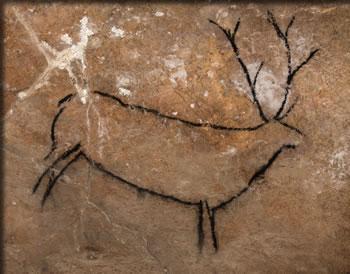 Black stag painting in Las Chimeneas cave in northern Spain.