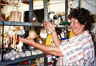 Ladies cooperative makes and sells crafts in Aduana.