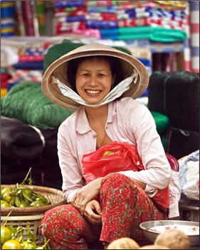 Woman selling vegetables in Hanoi, Vietnam.