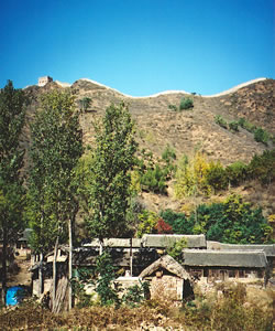 The Simatai Great Wall guards our rural village on Great Wall of China hiking vacation.