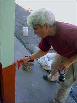 Painting a building in Peru: Volunteer Vacations with Global Volunteer Network.