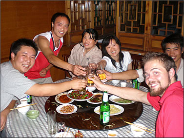Celebration dinner with staff and volunteers at a Panda conservation reserve in China.