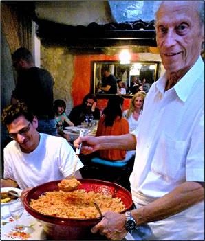Grotto Baldoria chef serving food in Ticino, Switzerland.
